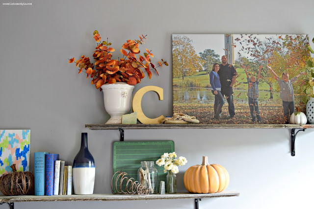 Rustic barnwood shelves decorated with fall decor