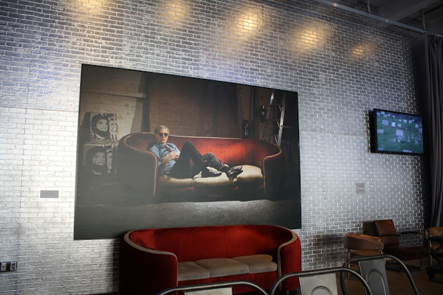 Andy Warhol chilling in a print in the cafe of the Andy Warhol Museum.