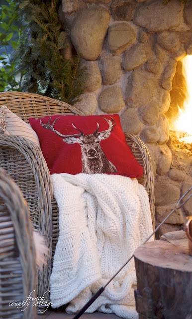 Christmas patio outdoors red Stag pillow fireplace