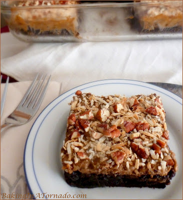 German Chocolate Brownies, the flavors of a German Chocolate Cake, along with a few surprise flavors, interpreted into brownie form.| Recipe developed by www.BakingInATornado.com | #recipe #chocolate #dessert