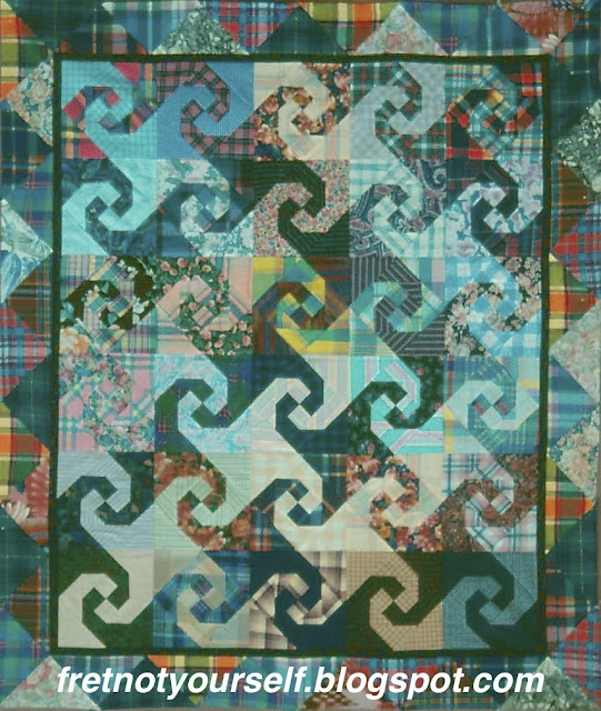 Virginia Reel blocks made with several Madras plaids.