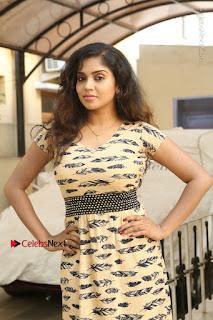 Telugu Actress Karunya Chowdary Stills in Short Dress at ATM Not Working Press Meet  0014.jpg