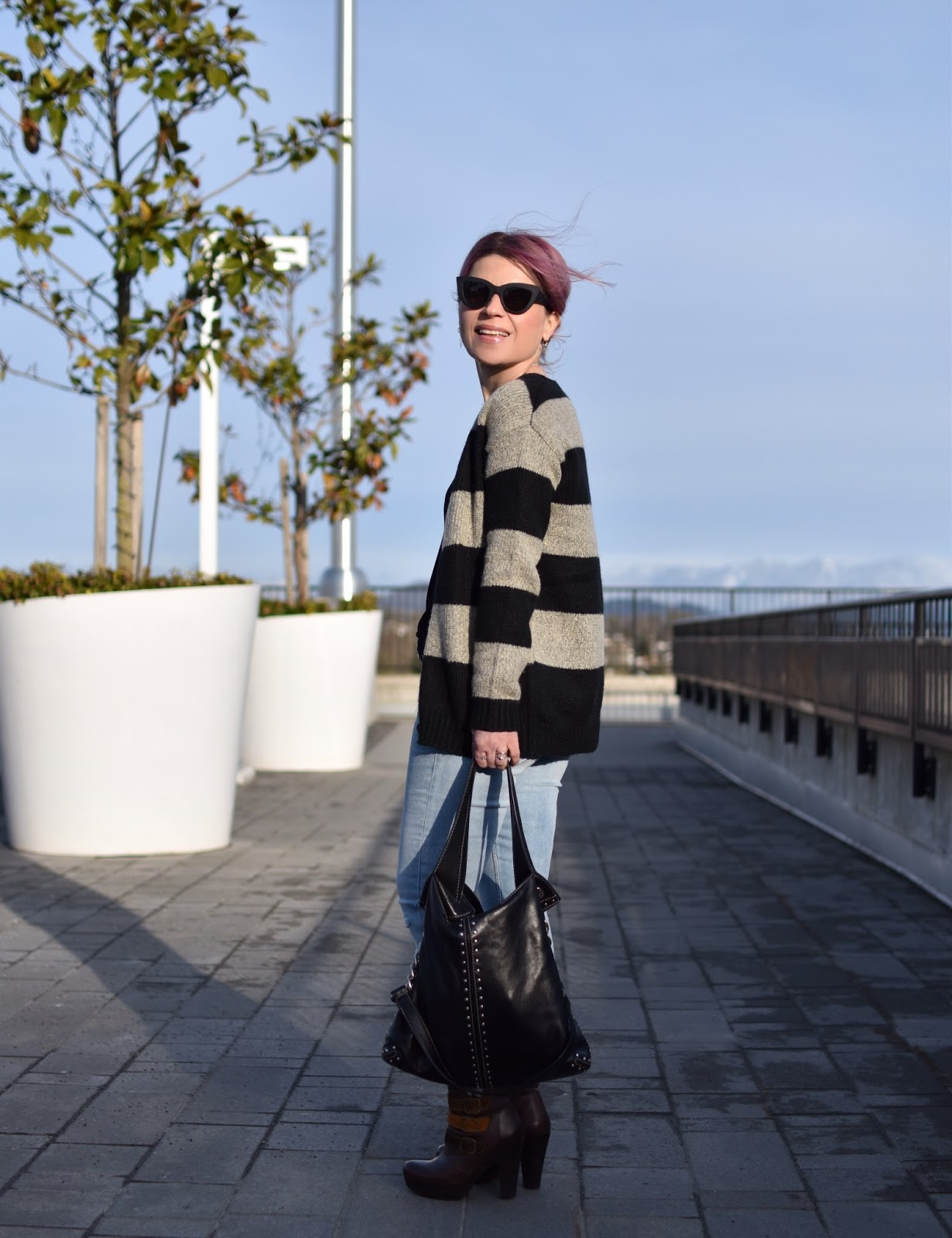 Monika Faulkner outfit inspiration - styling a striped grandpa cardigan with distressed skinny jeans, platform booties, and cat-eye sunnies