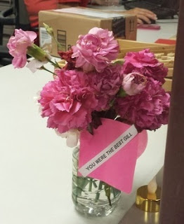 "pink carnations with ""YOU WERE THE BEST GIL"" card"