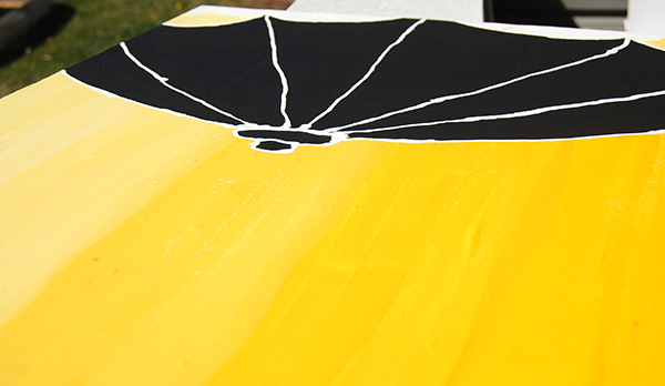 Yellow umbre black silhouette umbrella painting by Noami Foster upclose 2