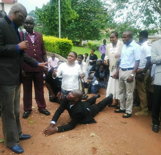 civil workers kneels to beg fayose
