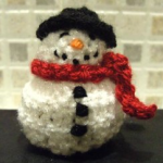 https://www.lovecrochet.com/snowman-chocolate-cover-decoration-crochet-pattern-by-kippers-ning