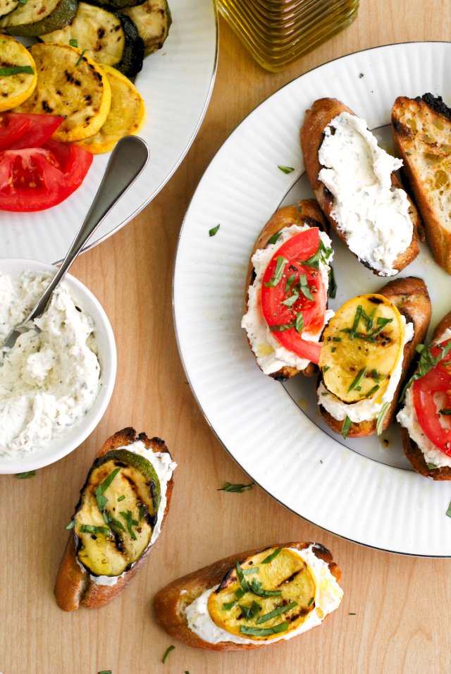 This Grilled Summer Squash and Tomato Crostini is the perfect summer appetizer featuring garden-fresh summer squash, tomatoes, and a Parmesan-herb cream cheese layered on a garlic toasted baguette.