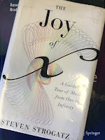 The Joy of X,  by Steven Strogatz, superimposed on Intermediate Physics for Medicine and Biology.