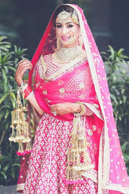 Gorgeous Indian Bride In Traditional Punjabi Wedding Dress.