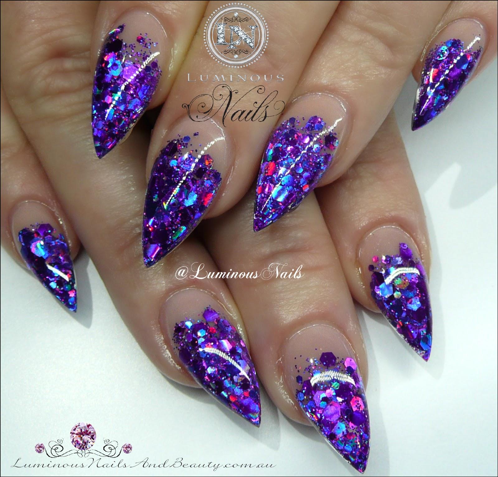 Luminous Nails: Stunning Glittery Indigo Acrylic Nails...