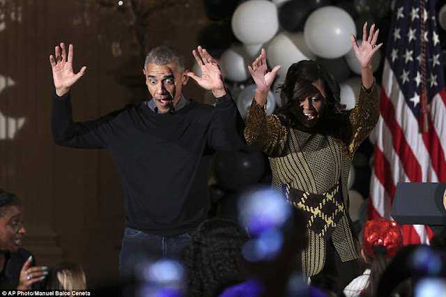 Barack and Michelle Obama perform Michael Jackson's 'Thriller' at White House Halloween party