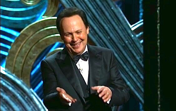 Billy Crystal smiling and gesturing with hands a foot apart