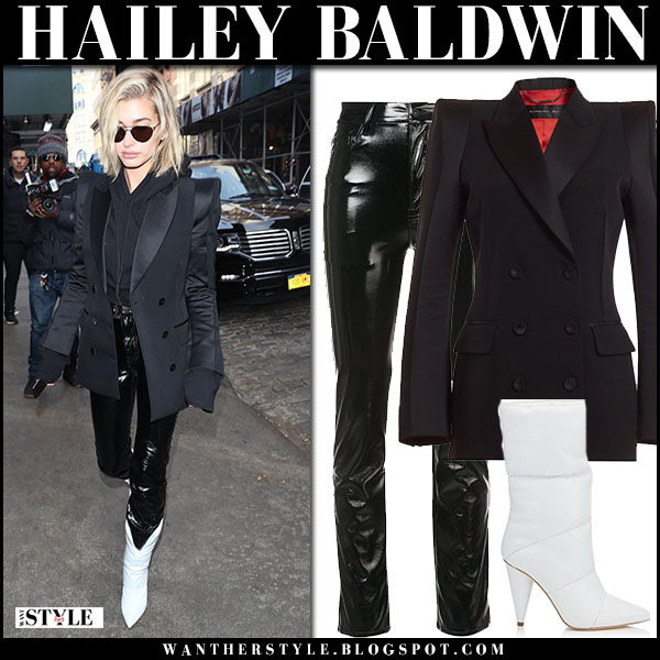 Hailey Baldwin in black jacket, black vinyl yeezy pants and white boots sara jimmy choo x off white model street style february 12