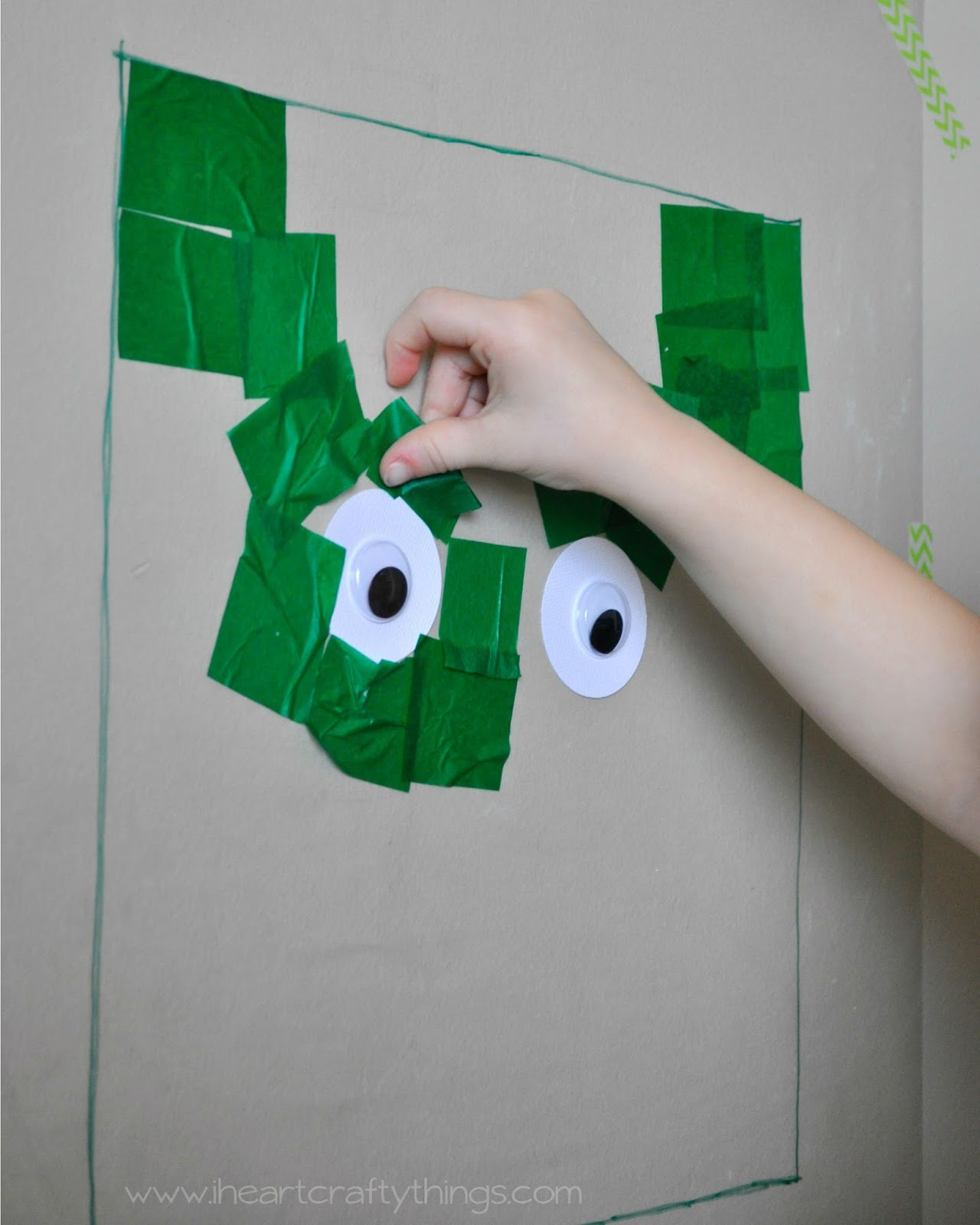 frankenstein paper after adding a couple pieces of tissue paper my daughter grabbed for the eyes and continued