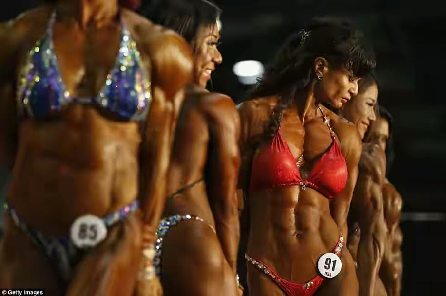 Muscular Women Gather In Hong Kong For Arnold Classic Muscle Building Competition Photos