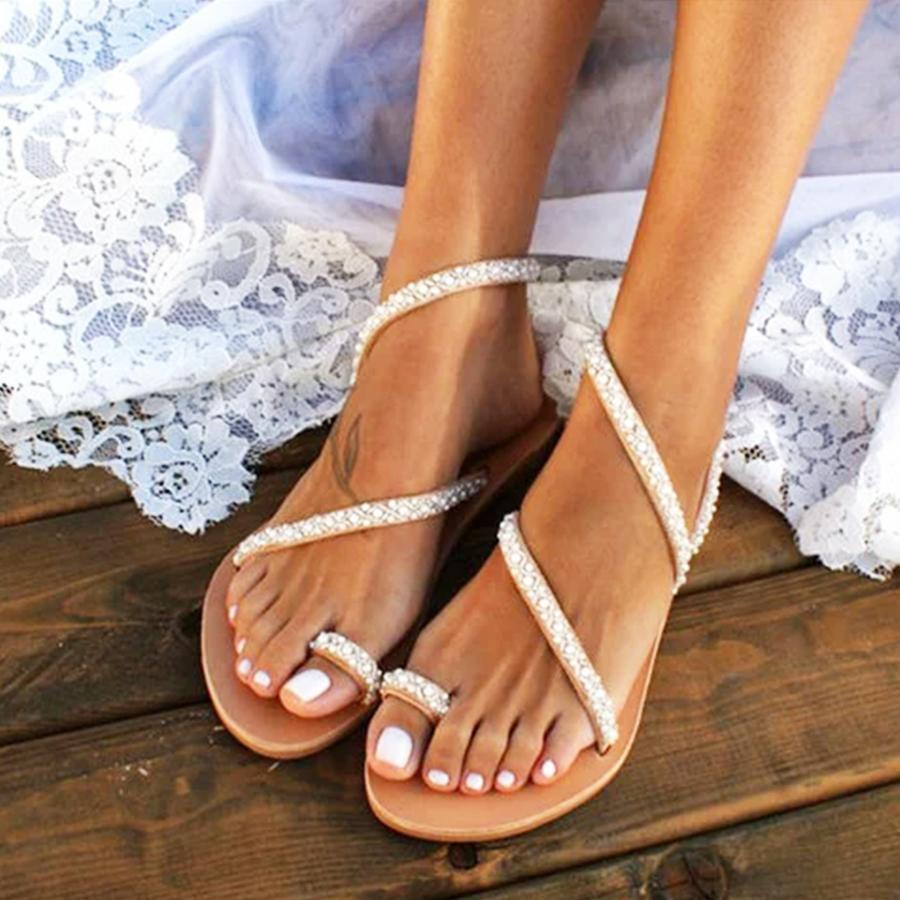 open toe sandals and white pedicure