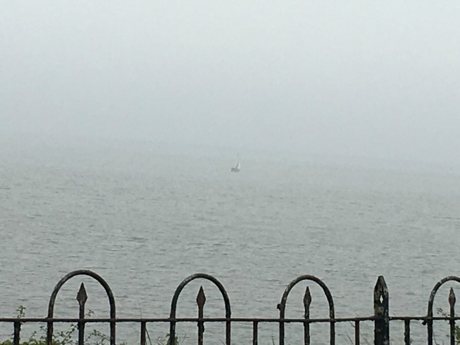 close-up-of-faint-image-of-sailing-boat-in-fog-near-Penarth