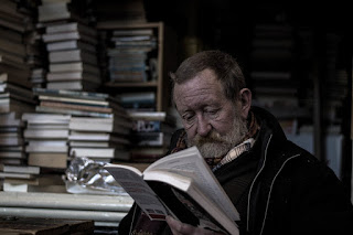 A man reading great books