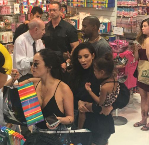 Kim and Kanye spotted at a candy store with their lovely daughter
