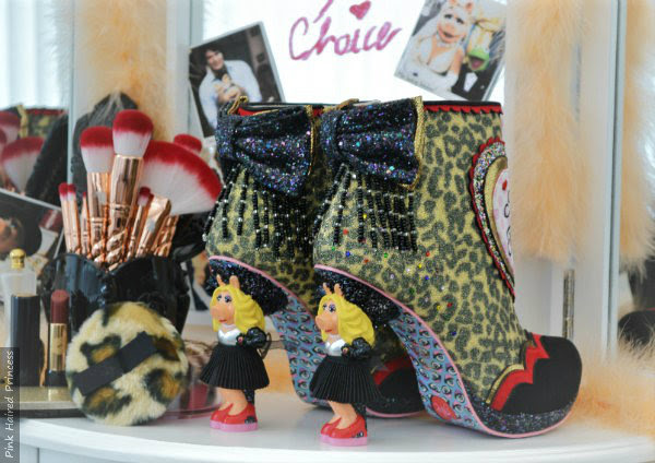 beaded fringed and glitter bow ankle boots on dressing table