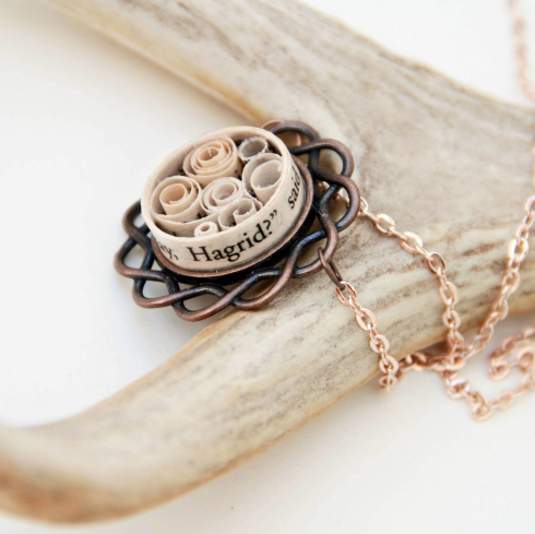 Circular Harry Potter-themed rolled book text pendant on bronze finding with rose gold chain