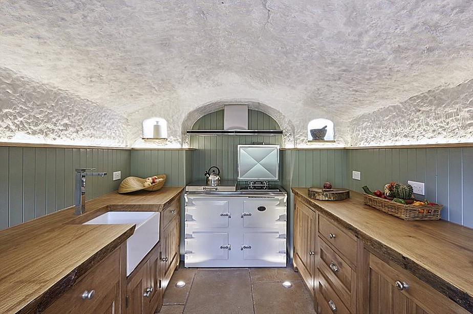 05-The-Kitchen-and-Aga-Angelo-Mastropietro-Caveman-Architecture-in-The-Rockhouse-www-designstack-co