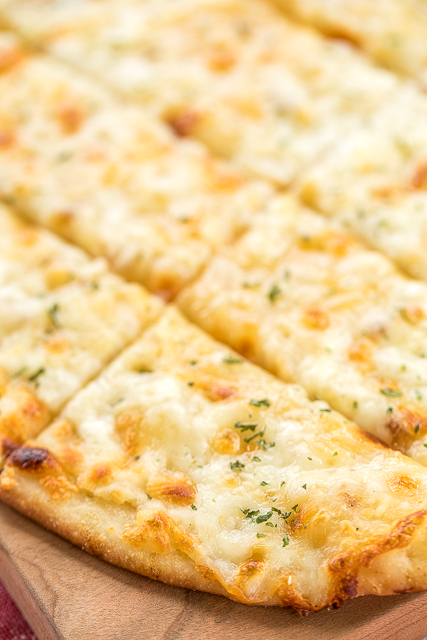 Secret Ingredient Cheesy Garlic Bread - 5 simple ingredients and ready in 10 minutes! Quick and easy bread recipe.