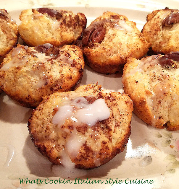 these are biscuit cinnamon rolls made in a cupcake tin. These biscuit cinnamon rolls are a semi homemade roll using a mix. The muffins are topped with cinnamon sugar, a glaze and pecans