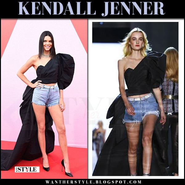 Kendall Jenner in black top with long train and denim shorts alexandre vauthier red carpet cannes may 21 2017 what she wore