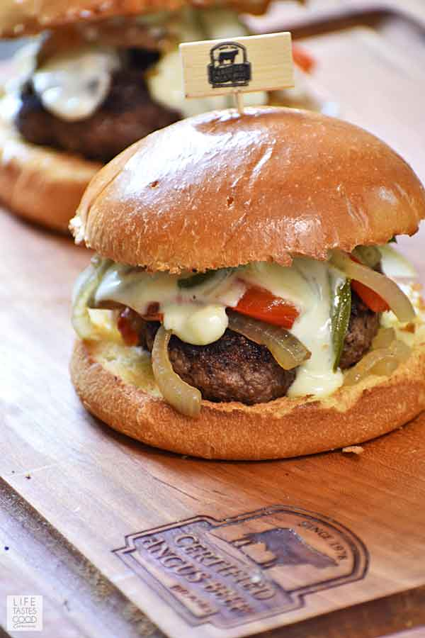 Philly Cheese Steak Burger with sauteed vegetables and Provolone cheese sauce dripping down