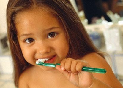 Busty girl brushes teeth