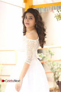 Actress Tejaswini Pictures in White Dress at Lachhi Teaser Launch  0054.JPG