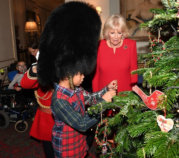 The Duchess of Cornwall is the patron of Helen and Douglas House and Roald Dahl Charity. red dress