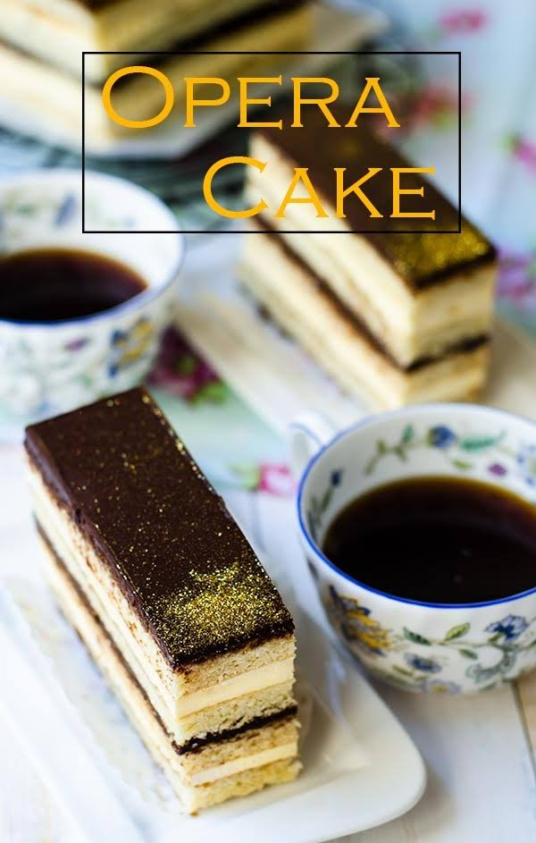 Opera cake consists of layers of almond sponge soaked in coffee syrup, chocolate buttercream, chocolate ganache and chocolate glaze.