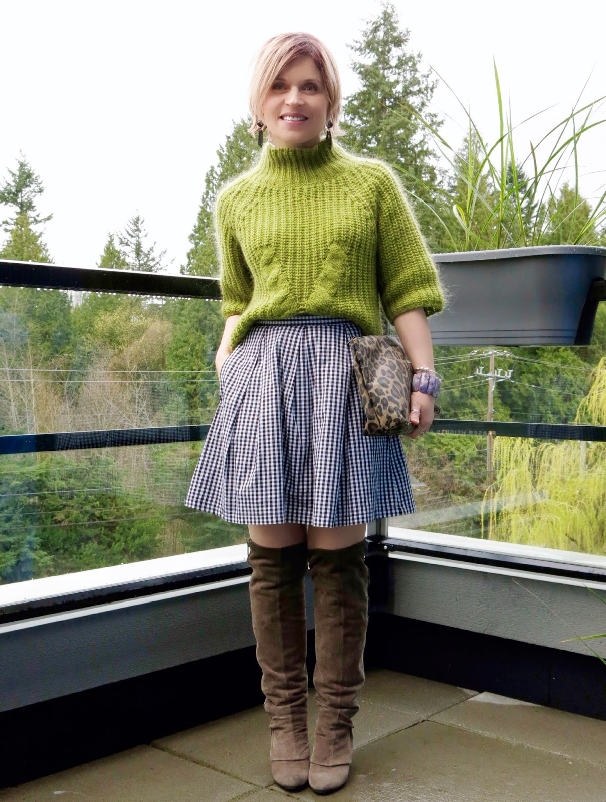 Rabbit season:  gingham skirt, funnel-neck sweater, and over-the-knee boots