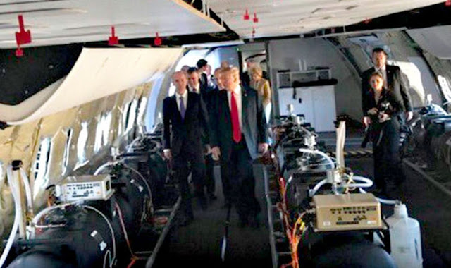 President Donald Trump visiting an airplane filled with chemtrail containers.