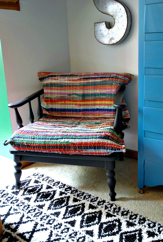 A easy DIY chair makeover using rag rugs to recover the cushions.