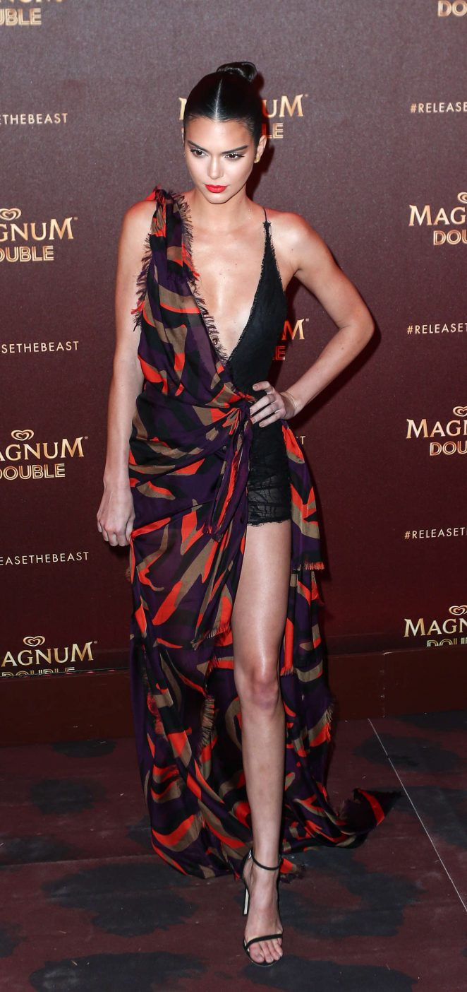 Kendall Jenner smoulders in braless Versace gown at the Magnum Cannes Party