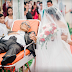 Bride's father joins daughter's wedding and accompany her while walking down the aisle with stretcher