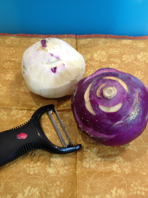 a peeled kohlrabi and a peeling knife