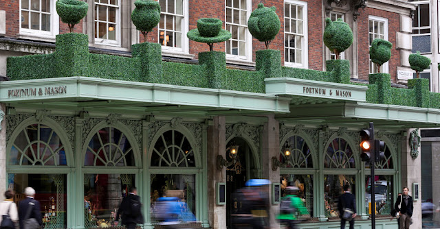 People passing by Fortnum & Masons shopfront
