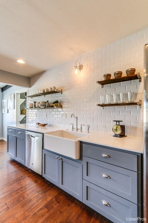 Blue and white #modernfarmhouse kitchen with open shelving and apron front farm sink.