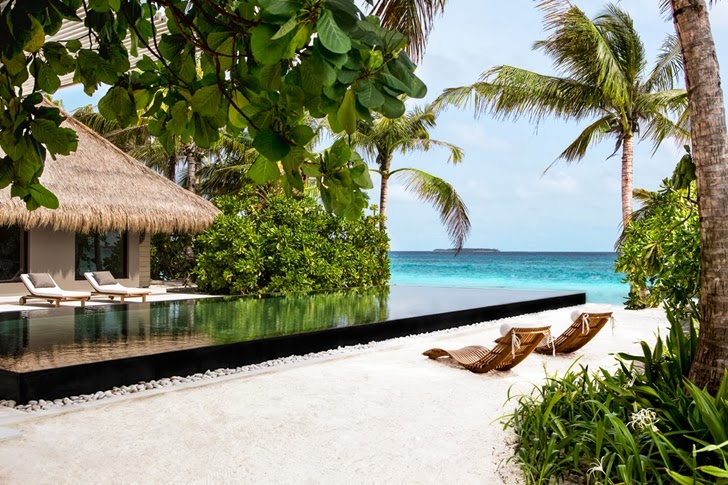 Swimming pool on the beach in Modern villa in Maldives by Jean-Michel Gathy