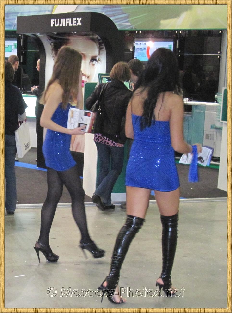 Promotional models in blue mini dresses