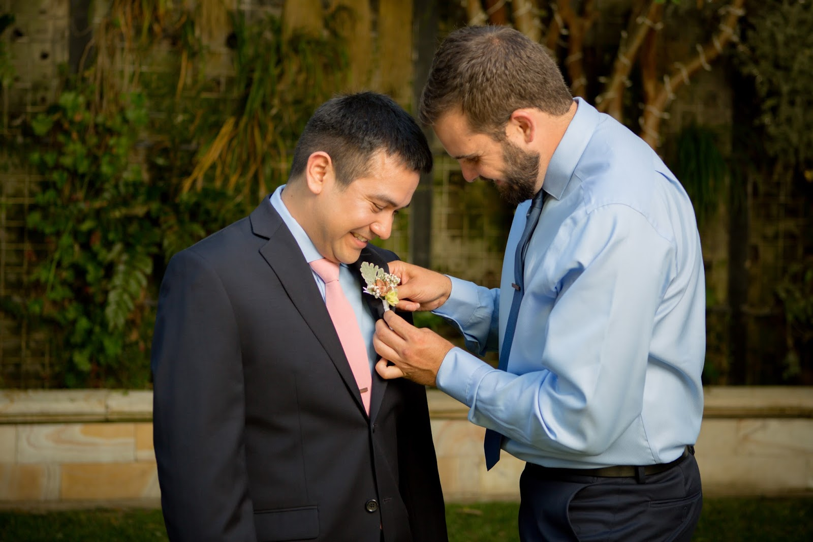putting on boutonnière at Brownstone
