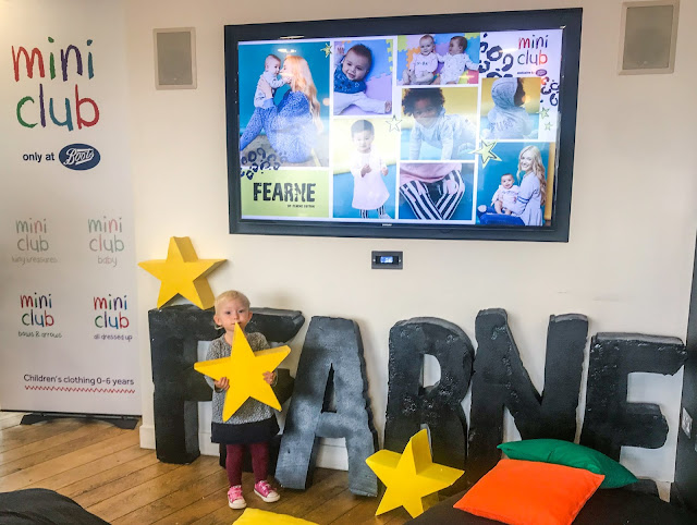 A child holding a star in front of large letters spelling out FEARNE and a TV screen showing some of the range