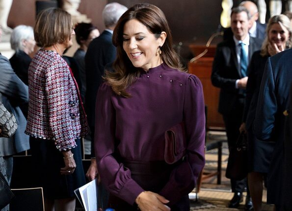Crown Princess Mary, wore a burgundy blouse and burgundy skirt, Prada suede pumps, she carries Hugo Boss clutch