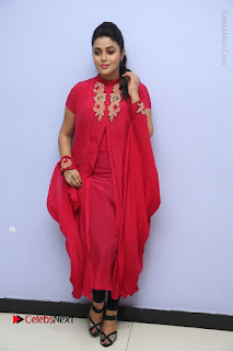 Actress Poorna Latest Stills in Red Dress at Rakshasi First Look Launch  0321.JPG
