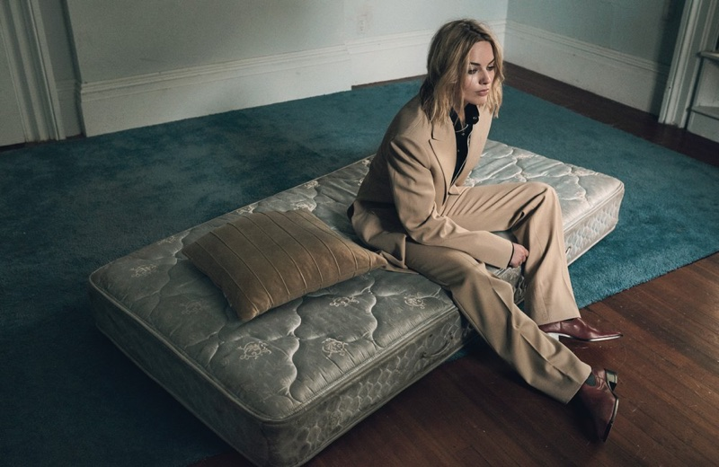 Margot Robbie wears Celine jacket, pants and boots with Linder shirt